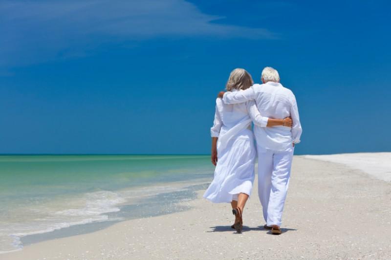 Retirees Walking on Beach