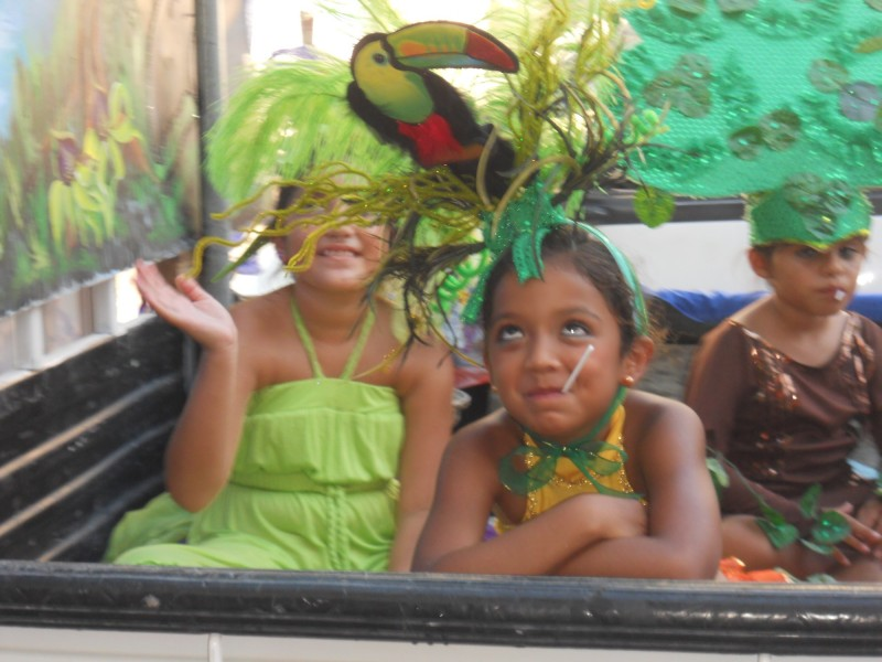Young Girls Enjoy Their Macaw Headress