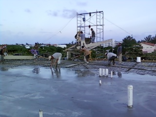 Building A Roof - Spreading Concrete on the Roof