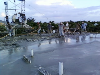 Workers on Bldg A Roof - Spreading Concrete