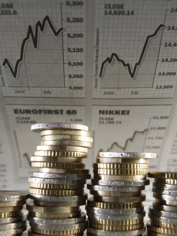 Coins-Financial-Graphs-in-Background-TS.jpg
