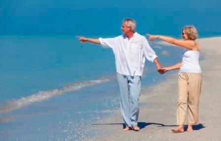 Happy_Seniors_Walking_Along_the_Beach