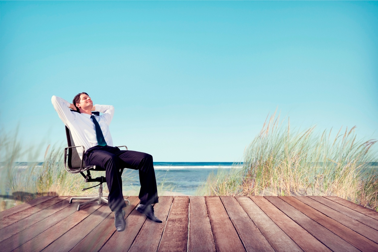 Business_Man_Relaxing_on_the_Beach