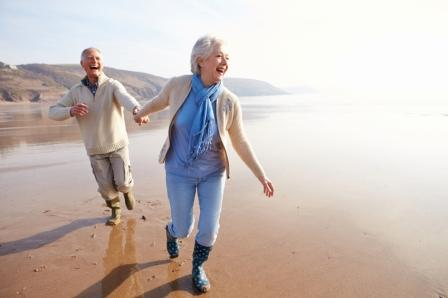Retirees_Happily_Running_on_the_Beach_IS